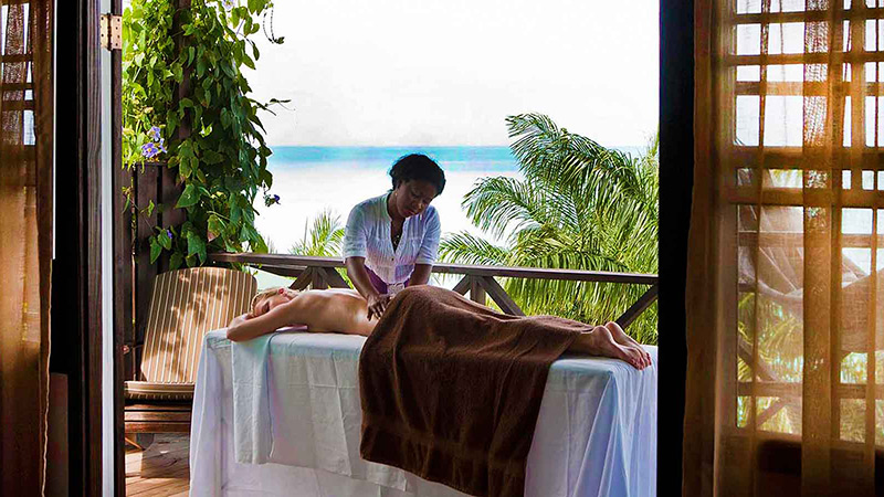 Woman getting a massage at Cocos Antigua