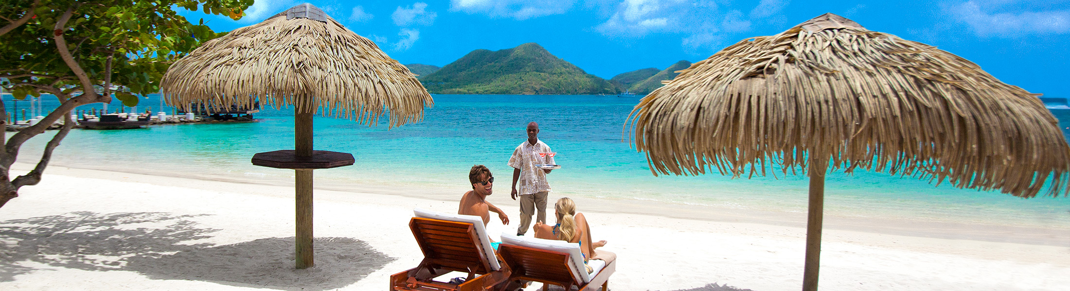 Butler service on the beach at Sandals Grande St Lucian