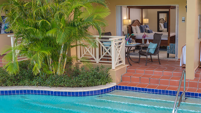 Pool access in the Swim-up Lover's Lagoon Club Level room at Sandals Grande St Lucian