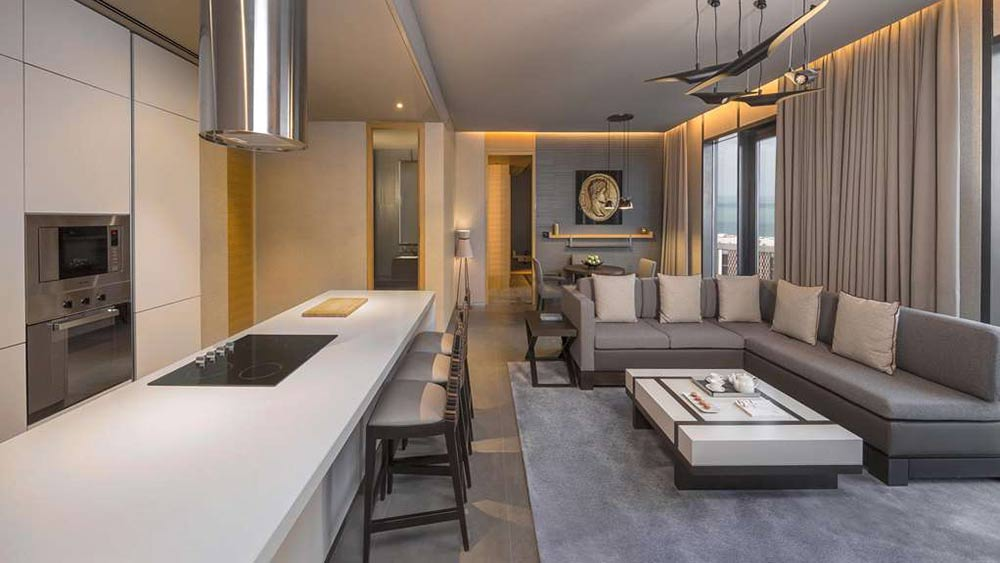 Kitchen and living room of the Two Bedroom Residence Suite at Caesars Palace Bluewater