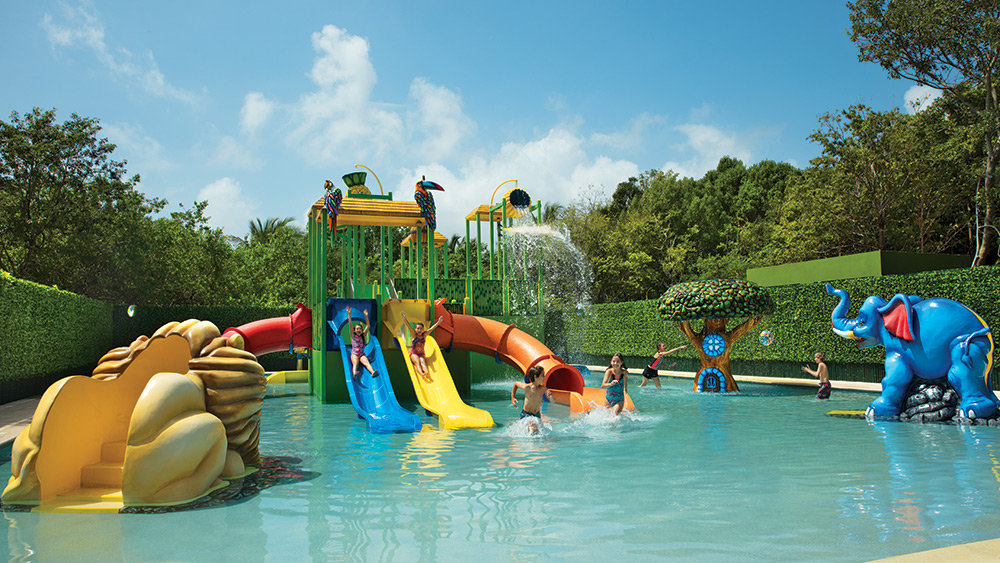 Children on a water park at Dreams Tulum Resort & Spa