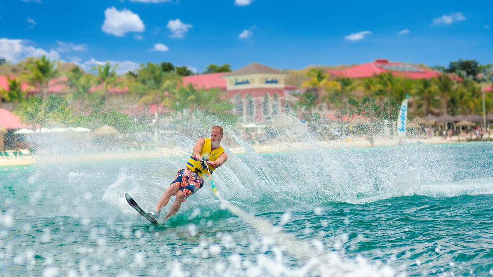 Man waterskiing at Sandals Grande St Lucian