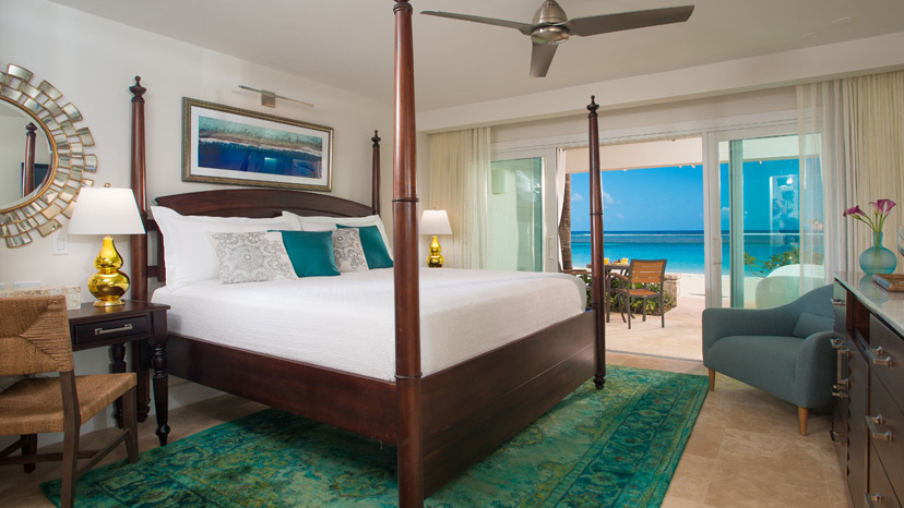 Bedroom of the Windsor Beachfront Walkout Club Elite Room at Sandals Royal Caribbean