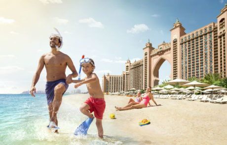 father and son playing on the beach at the Atlantis The Palm