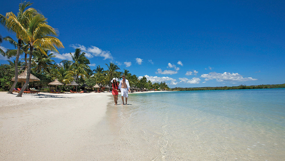 Couple walking on the beach at Constance Prince Maurice