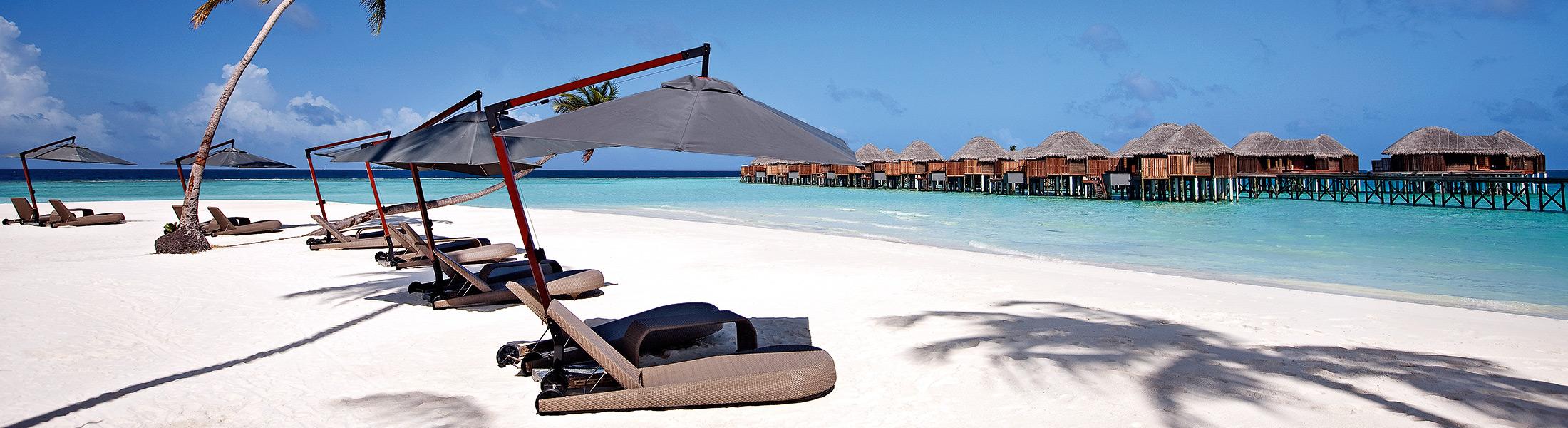Beach sun loungers at Constance Halaveli