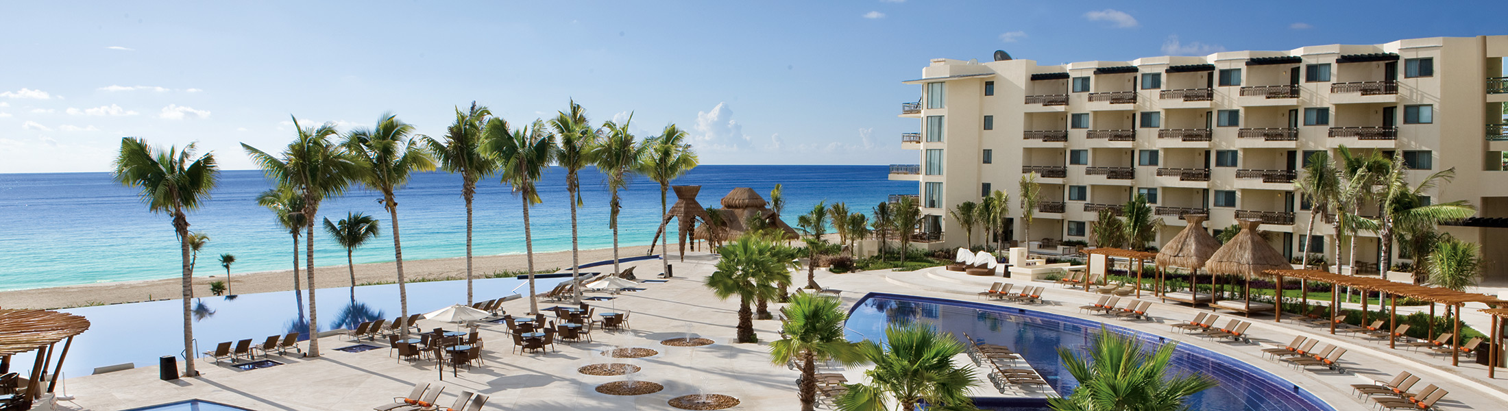 Aerial view of the main pool and beach at Dreams Riviera Cancun