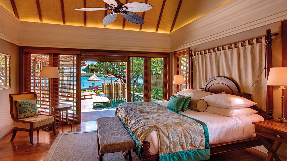Bedroom with a view of the private pool in the Beach Villa at Constance Prince Maurice