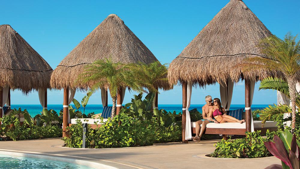 Couple relaxing in a cabana at Dreams Playa Mujeres