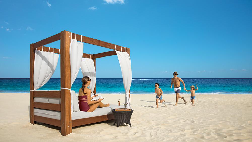 Family on a cabana at the beach at Dreams Riviera Cancun