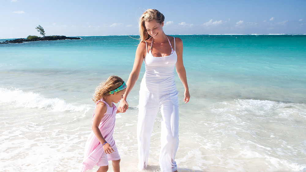Mother & daughter at the beach at Constance Belle Mare Plage