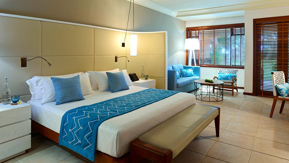 Bedroom of the Junior Suite at Constance Belle Mare Plage