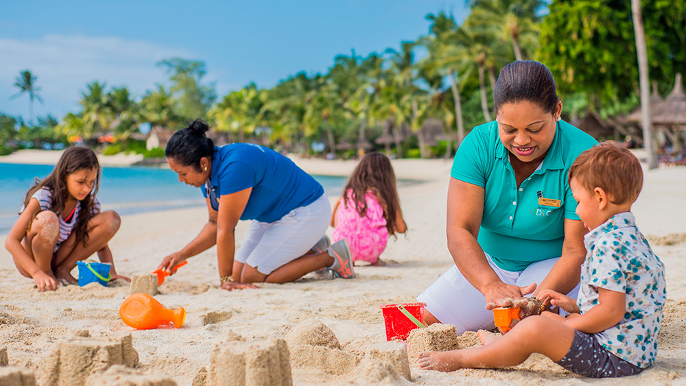 Supervisors and children at the beach at Constance Prince Maurice