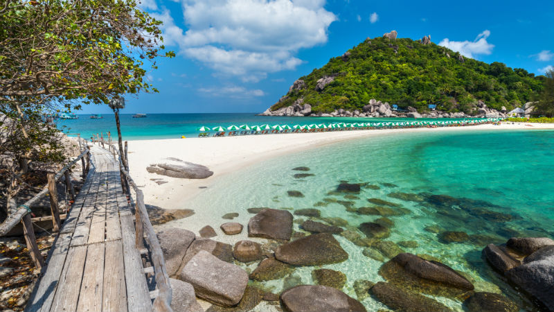 Rocky beach with blue water in Koh Tao