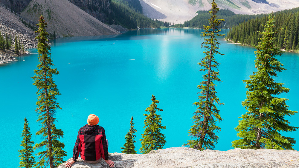 Person looking over Lake Moraine in Banff