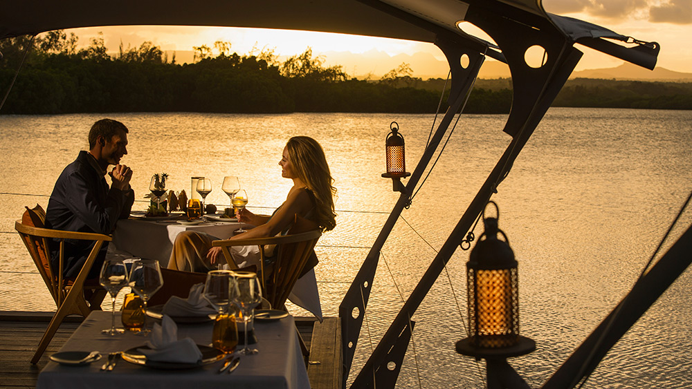 Couple having dinner at Constance Prince Maurice