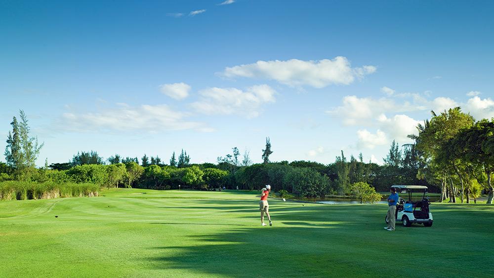 Woman playing golf at Constance Prince Maurice
