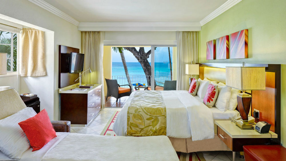 Oceafront Room with Sleeper Chair at the Tamarind by Elegant Hotels
