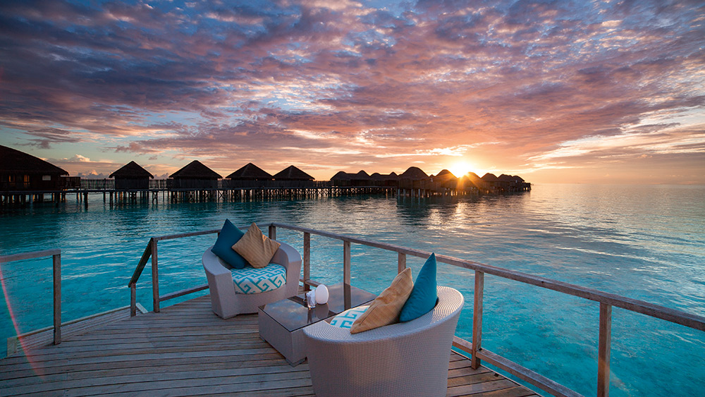 Sunset at the overwater lounge at Constance Halaveli