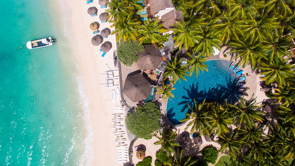 Aerial view of the pool and beach at Constance Belle Mare Plage