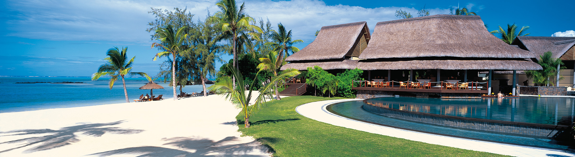 Infinity pool and beach at Constance Prince Maurice