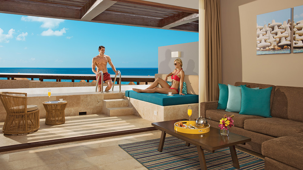 Couple on the terrace of the Preferred Club Junior Suite Swim Out Ocean View at Dreams Playa Mujeres