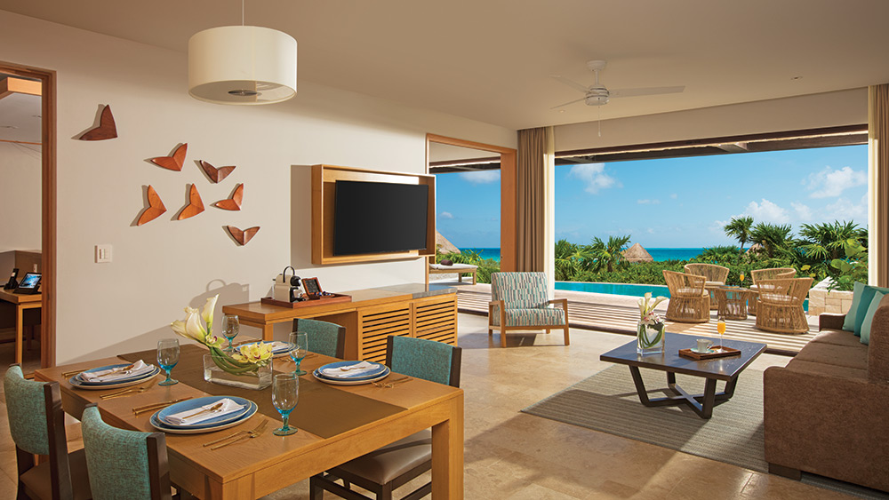 Living room of the Preferred Club Master Suite Ocean Front with Private Pool at Dreams Playa Mujeres