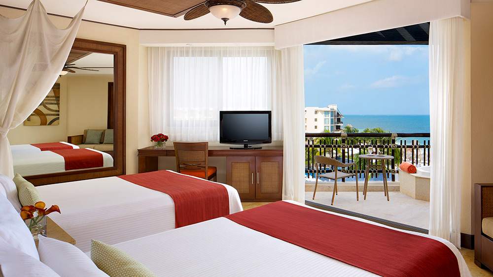 Bedroom of the Preferred Club Ocean View Room at Dreams Riviera Cancun