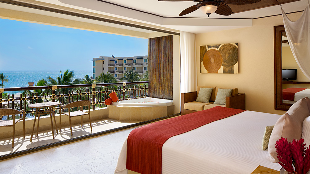 Bedroom of the Preferred Club Ocean View & Pool Front Room at Dreams Riviera Cancun