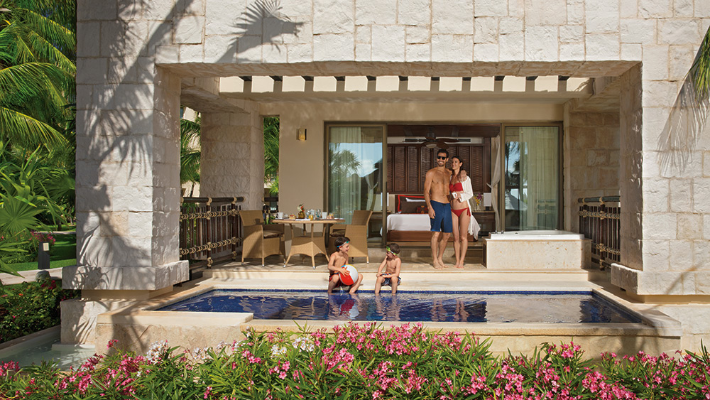 Family in the private pool of the Premium Deluxe with Plunge Pool Room at Dreams Riviera Cancun