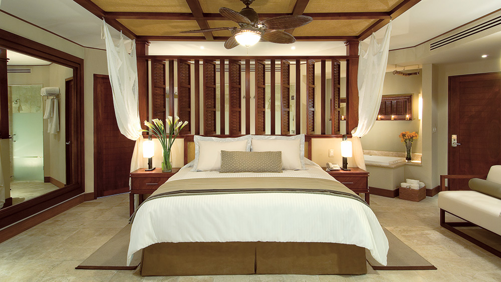 Bedroom of the Premium Deluxe Room at Dreams Riviera Cancun