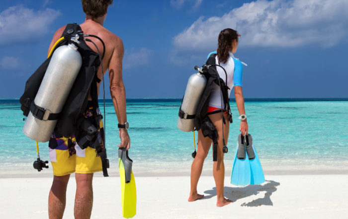 Scuba diver couple with diving equipment