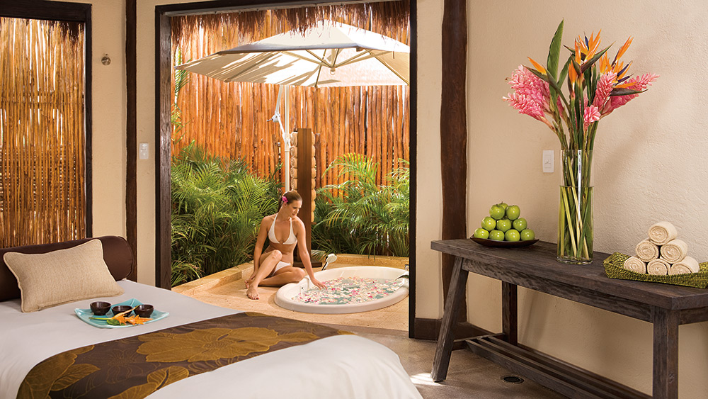 Woman enjoying the spa treatment room at Dreams Riviera Cancun