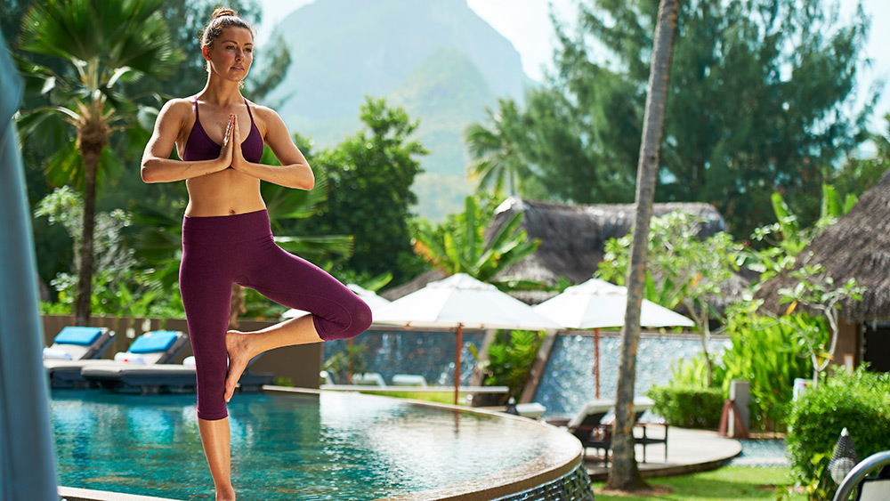 Woman doing yoga at Constance Ephelia