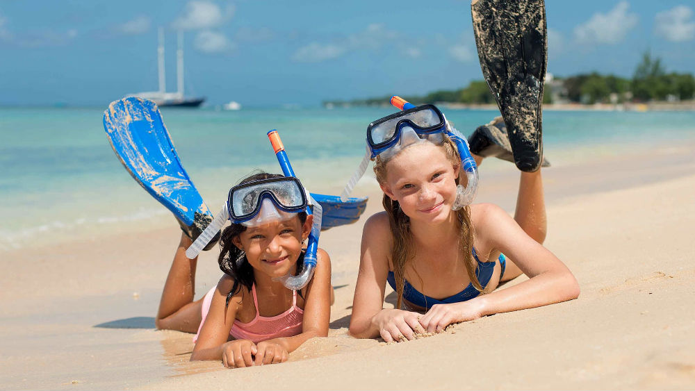kids on the Beach at the Tamarind by Elegant Hotels