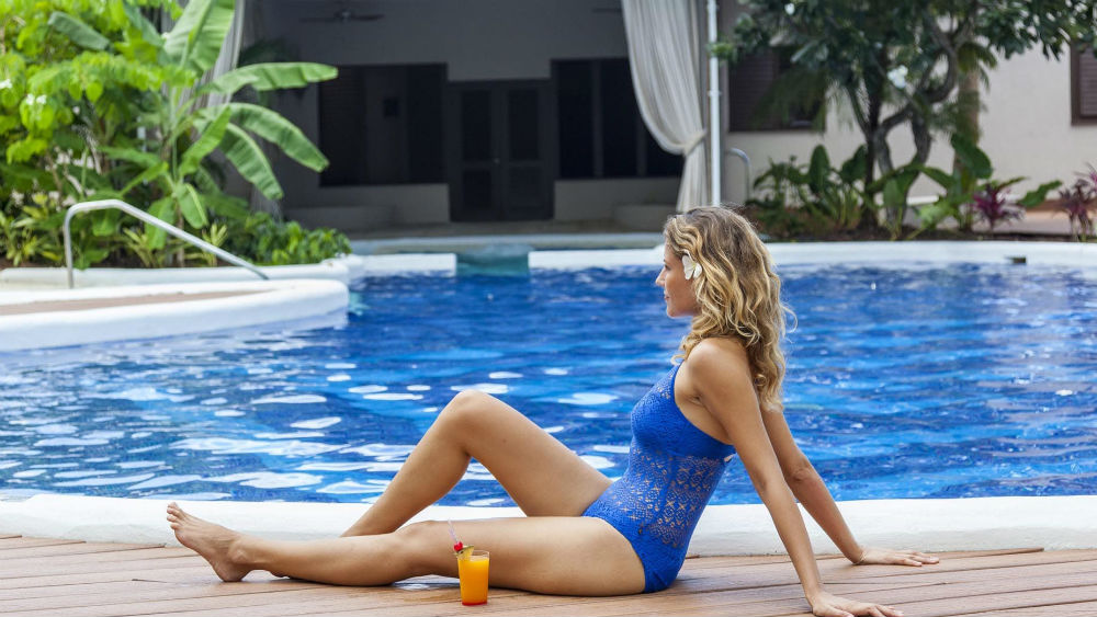 lounging by the pool at the Waves Hotel & Spa by Elegant Hotels