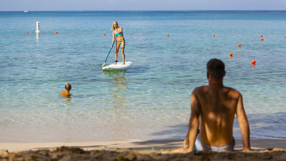 Paddle boarding at the Waves Hotel & Spa by Elegant Hotels