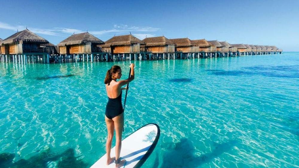 paddle boaring at the Constance Moofushi Maldives