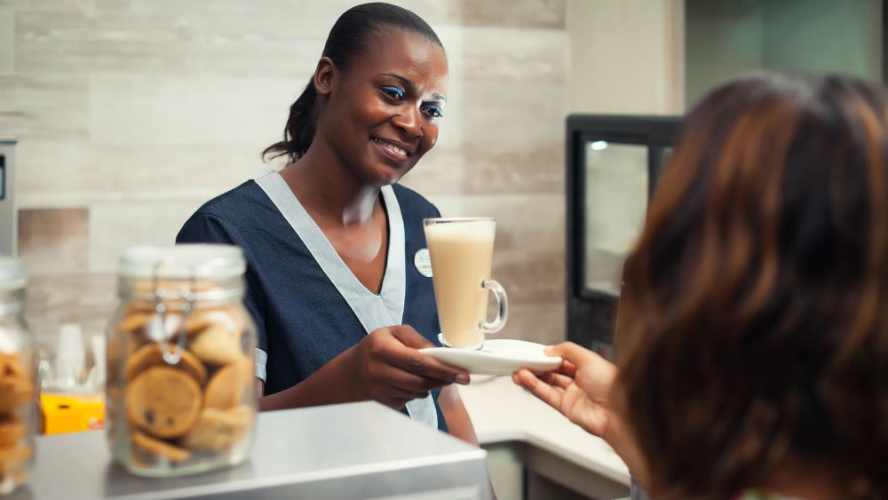 serving coffee at the Waves Hotel & Spa by Elegant Hotels
