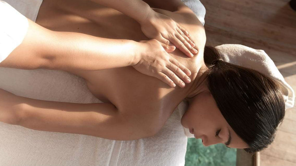 spa massage at the Constance Moofushi Maldives