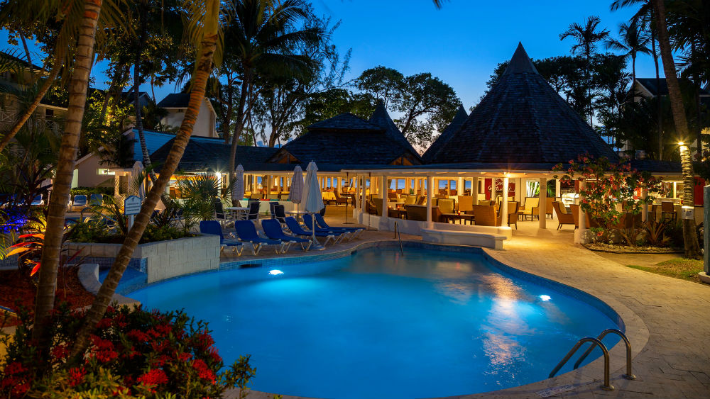 swimming pool at night at The Club Barbados Resort & Spa, Barbados