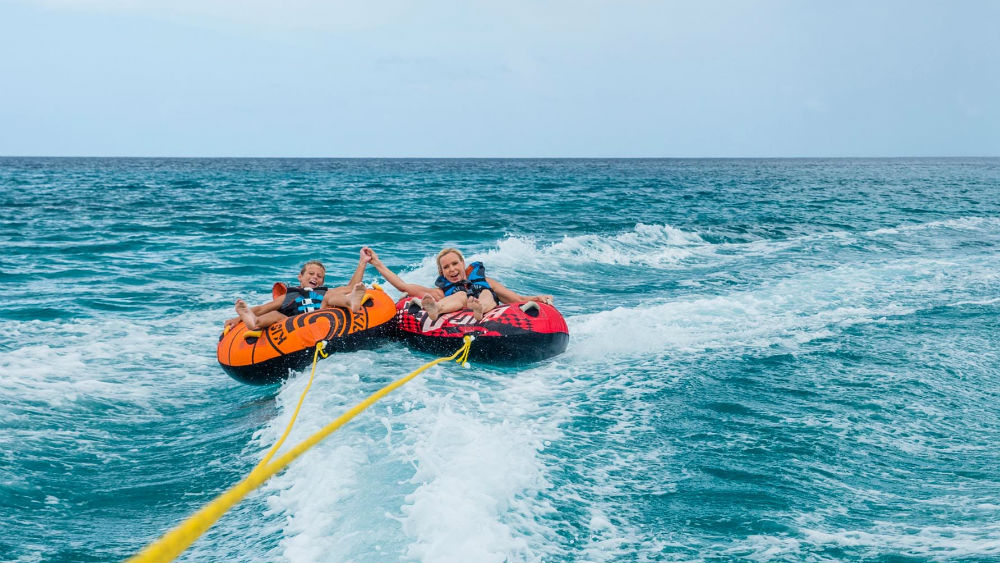 water skiing at the Tamarind by Elegant Hotels