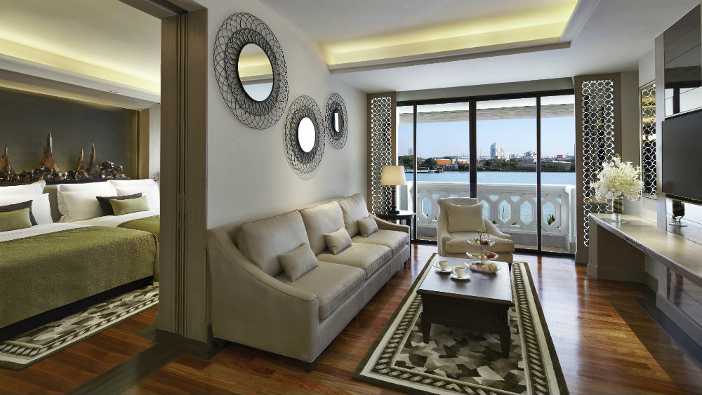 2 Bedroom River View ChaoPhraya River Suite Living room at the Anantara Riverside Bangkok Resort