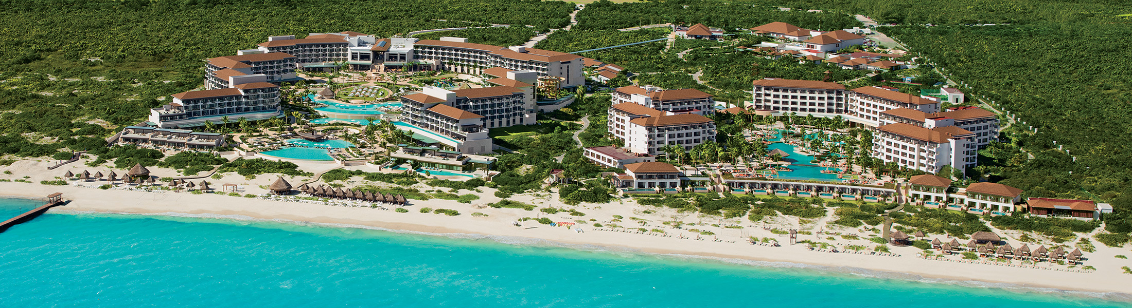 Aerial view of beach and Secrets Playa Mujeres