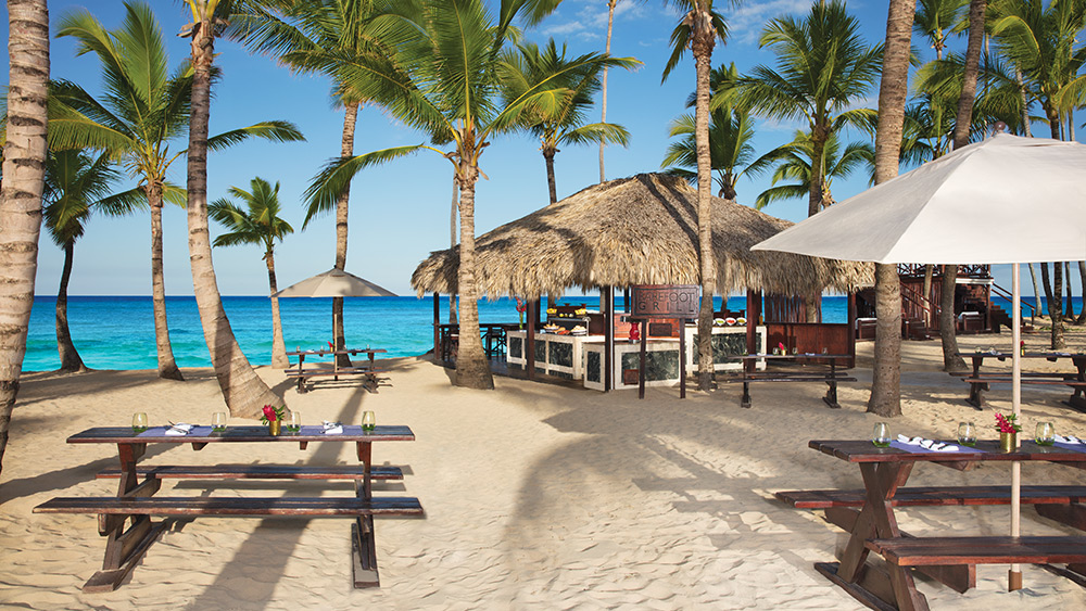Outdoor dining in Barefoot Grill Restaurant at Dreams Punta Cana