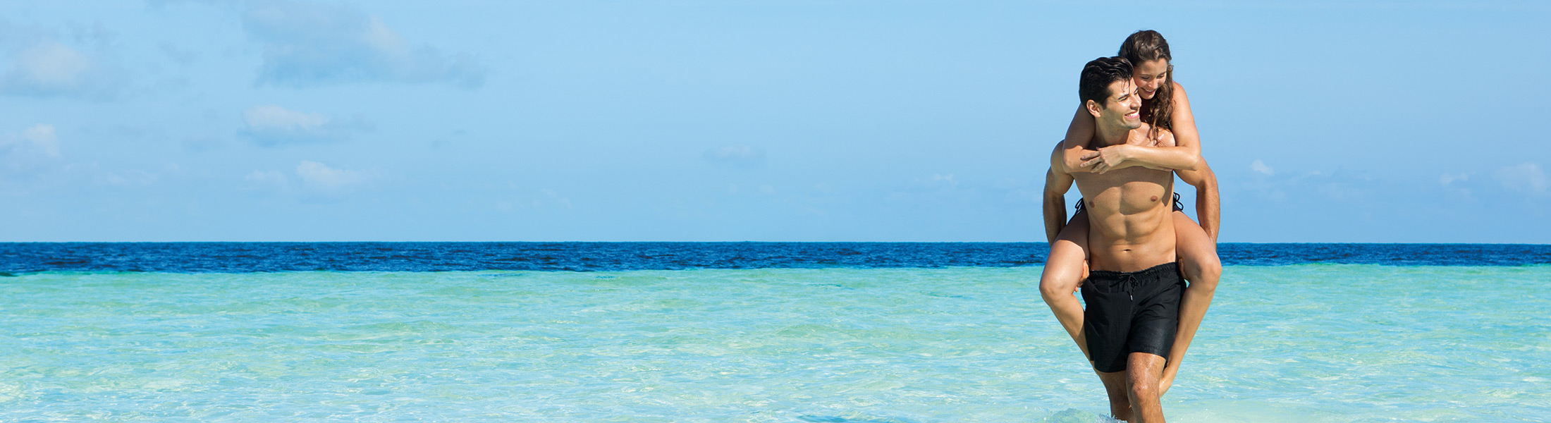 Couple standing in the sea at Dreams Sands Cancun Resort & Spa