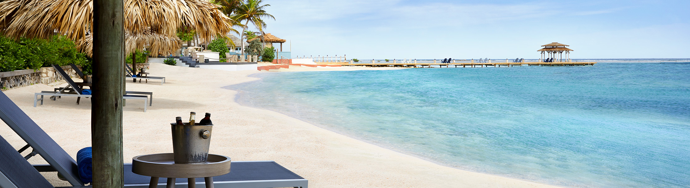 Sun loungers on the beach at Zoetry Montego Bay