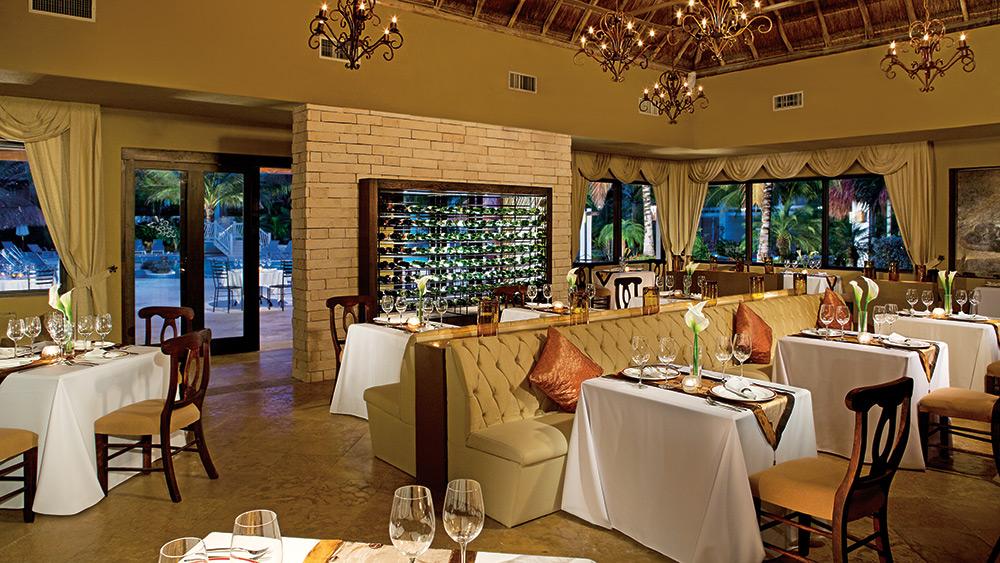 Dining area of Bordeaux Restaurant at Secrets Aura Cozumel