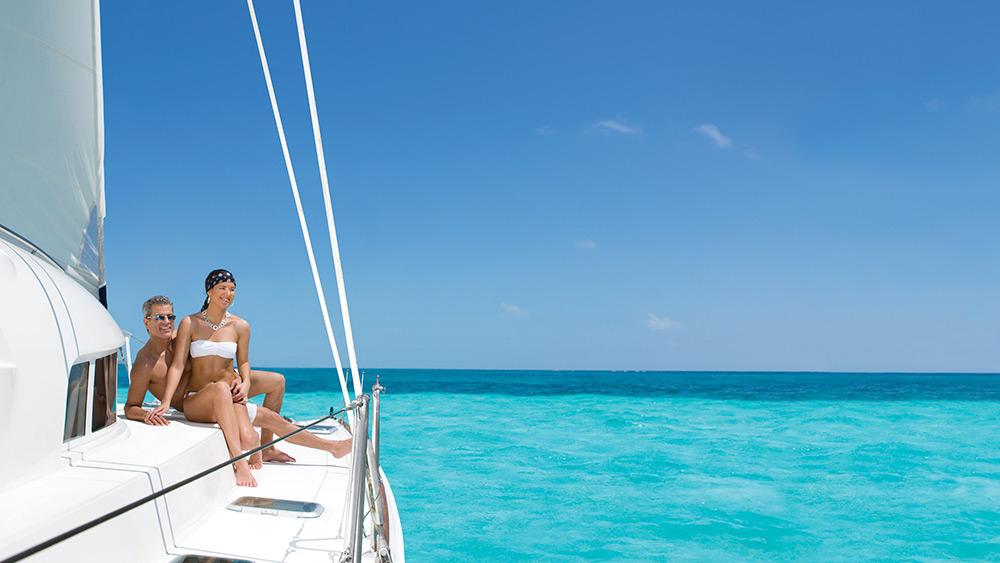 Couple on a catamaran at Zoetry Paraiso de la Bonita