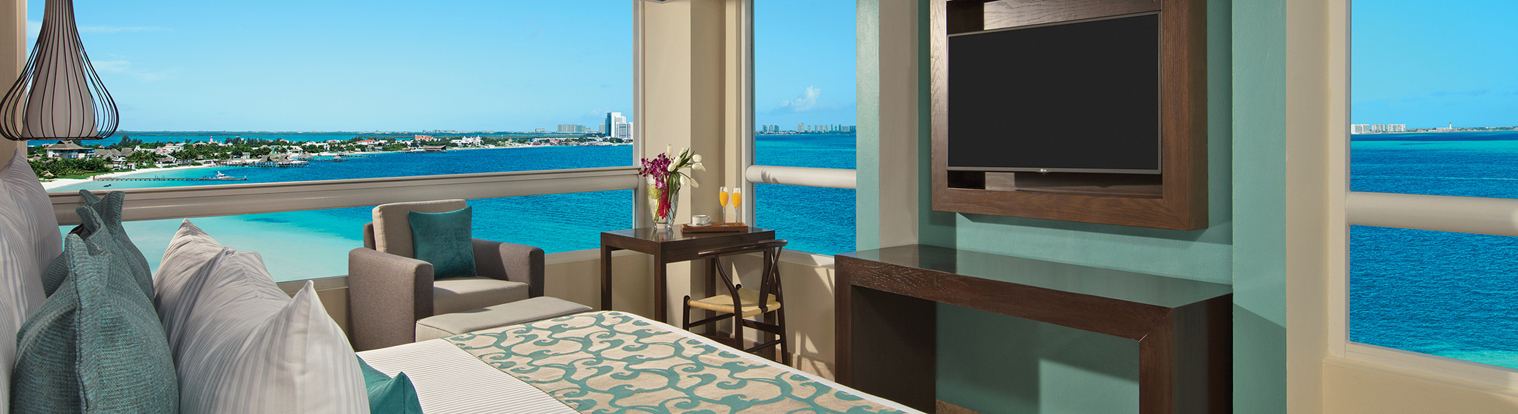 Bedroom with ocean views at Dreams Sands Cancun Resort & Spa